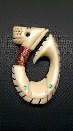 cool hand carved bone hook pendant, you have to check out the rest of this guys work!