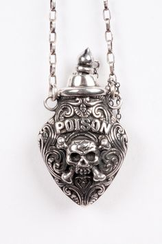 Poison necklace by Nick Von K. This necklace has a hand-carved poison bottle with removable dipper in sterling silver