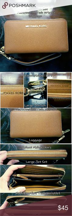 Michael Michael Kors Wristlet Wallet MICHAEL Michael Kors large Jet Set Multifunction Tech Wristlet in Luggage made with Saffiano leather. A wraparound zip reveals a lined interior with a dividing zip pouch, a phone pocket, a bill pocket, and 3 card slots. Fits iPhones. Optional wristlet strap. NEVER BEEN USED, but tags were removed. MICHAEL Michael Kors Bags Clutches & Wristlets