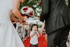 The cutest of little boy wedding guests carrying the ring, on French Wedding Style