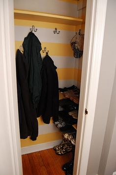 Coat Closet redo!! Ok, ok, I'm not going to attempt the stripes but I love the idea of the hooks instead of a rod. And maybe even the shelves on the side!