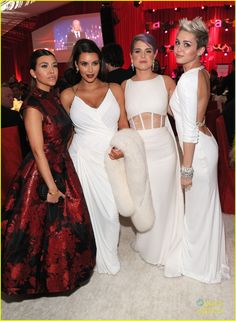 Kim and Kourtney Kardashian, Kelly Osbourne, and Miley Cyrus