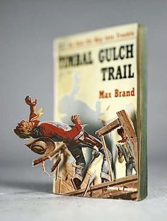 """Thomas Allen brings literary characters to life in his series of paper """"dolls"""" cut from vintage book illustrations."""