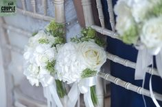 Flowers decorate the chairs of the bride & groom in their church ceremony. Weddings at Cabra Castle photographed by Couple Photography. Glenda, Church Ceremony, Love At First Sight, Couple Photography, Bride Groom, Wedding Bouquets, Floral Wreath, Castle, Bloom