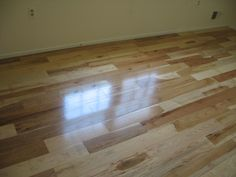 """This is a view of the upstairs bedroom now containing a high quality prefinished 5"""" Hickory hardwood floor ."""