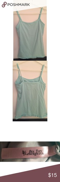 Victoria's Secret shelf bra camisole RARE!! This item is part of the fashions best kept secret bra top collection. This collection is no longer being sold in stores or online. Light blue/turquoise color, built in shelf bra, thick stretchy material for a form fit, can be worn as a tank top, camisole, or as a sleepwear top. Perfect condition, only worn once. PINK Victoria's Secret Tops Camisoles