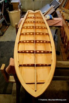 Cool website that shows you the steps in making a custom wood surfboard and wood boats.: