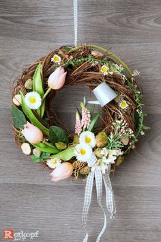 Türkranz Frühling mit Gießkanne A durable door wreath with silk flowers, different ribbons, wood heart, small watering can, dried materials and many details that want to be discovered. Spring Door Wreaths, Easter Crafts, Silk Flowers, Seasonal Decor, Flower Pots, Christmas Holidays, Diy And Crafts, Ideas, Wreaths