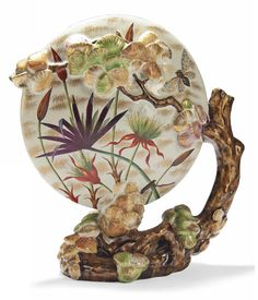 AN EMILE GALLÉ FAIENCE MOON SHAPED VASE  LATE 19TH CENTURY  The vessel with two apertures, supported by a branch, painted with flowers and moths, heightened with gilt, printed EG with Cross of Lorraine, Emile Gallé posé á Nancy