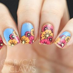 Manicure using reverse stamping floral decals