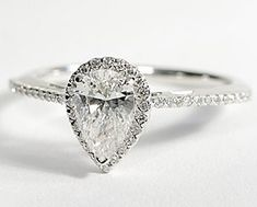 Pear Shaped Halo Diamond Engagement Ring in 14K White Gold. Amazing