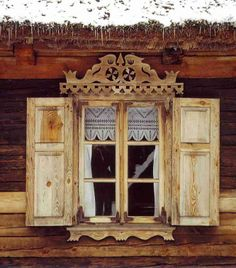 beautiful window and curtain with shutters. rustic. ornate