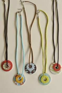 Craft idea: Washer necklace - supplies - 2 size washers, scrapbook paper, mod podge and diamond glaze by