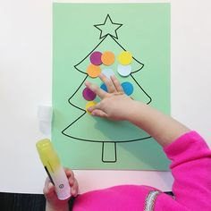 Easiest christmas tree activity - J practiced with our circle puncher and then glued all the colourful 'ornaments' onto the tree 🎄