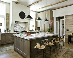 The rugs.  The rustic paneling.  The marble backsplash and counter.  The whole damn thing is perfection.