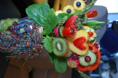 Veggie and fruit bouquet.     cute in the middle of a fruit  veggie tray