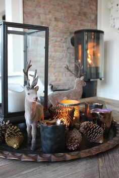 A tray, a lantern, a couple of deer, candles and pine cones = a totally do-able centerpiece!