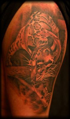 I watch Ink Master on Spike TV, but not faithfully. But I do really love this photo realism tattoo that Lea Vendetta did. I'd get this... but its way too big for my taste!
