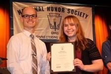 OCA students Emily and Sarah Robinson inducted into National Honor Society  Also pictured is OCA teacher Mr. Adam Warniment