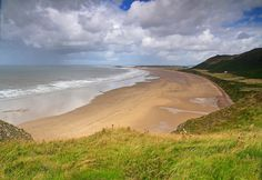 Rhossili Bay Beach, Swansea.  There's no need to head to Spain during the Summer when there's spectacular beaches like Rhossili Bay lining the Welsh coastline. | 25 Places In Wales You Won't Believe Are Real