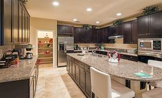 We can't stop staring at this kitchen in Lennar at Carrera at D'Andrea in Sparks, NV! What would you do with a large kitchen island like this? #kitchen #island