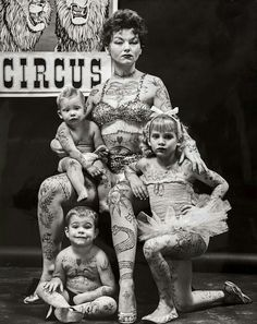 Tattooed mom & kids... Remember some families did not have a choice they did what they had to, to earn money!
