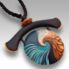 Ocean Sorano Pendant by Swirl Stone. This sculpted polymer clay pendant is available in two sizes. Lentil shaped center piece has identical patterning on both sides. American Made. 2013 Buyers Market of American Craft.