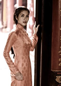 Tang Thanh Ha, a famous actress of Vietnam is wearing ao dai dress and 60s make up style.