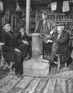 Civil War/Greece  Citizens of Kastonia sitting around the stove in the general store chewing fat.Location:Louzesti, Greece  Date taken:December 1947  Photographer:John Phillips