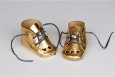 20 Adorable DIY Baby Clothes: DIY Gold Leather Shoes