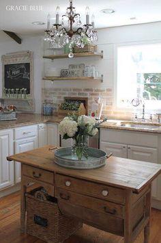 Absolutely stunning kitchen! Love the light fixture, color scheme and brick backsplash! #designinspiration #rusticshabbychickitchen