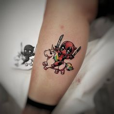 Deadpool win Unicorn tattoo by Daniele Maiorano