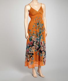 When the days get warmer and the sun shines brighter, it doesn't mean hemlines have to get shorter. With sophisticated styling and a flowing silhouette, this maxi boasts feminine florals to catch every eye, while the shirred torso creates a stretchy fit to make it suitable for a day-to-night outfit.