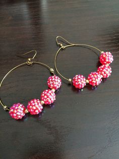 A personal favorite from my Etsy shop https://www.etsy.com/listing/236387222/pink-sparkling-beaded-hoop-earrings