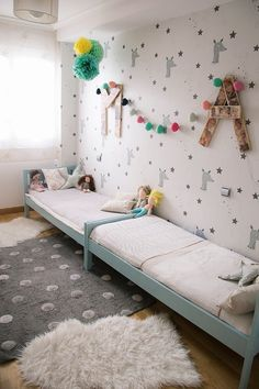 Swap the beds for two cribs and you've got a gorgeous gender neutral room for your twins. Love the way all the patterns and tones of grey work together.