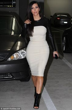 Kim Kardashian stepped out for a business meeting in Santa Monica today, clad in a form-fitting black and white dress