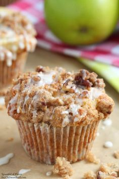 Apple coffee cake muffins for fall! Chunks of apples, crumble topping, chopped pecans and glaze combine to create a breakfast treat or afternoon snack!