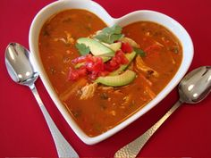 1  onion  2 TB veg oil  2 (31 oz) cans of refried beans   2 (16 oz) cans diced tomatoes,   2 (10 oz) cans diced tomato chili  2 (14 oz) cans chicken broth  4 TB cilantro  4 cups Jack cheese  2 8 oz sour cream    -Cook onion and garlic in oil with cover. medium heat, stirring constantly  til tender  -Add Beans, tomatoes (both types), chicken broth. Stir til smooth; Bring to  boil. Reduce heat, simmer 15 minutes, stir in cilantro