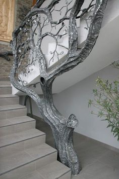 - Stairway Designs & Ideas - Tree railing / bannister in silver, growing beside staircase. Tree railing / bannister in silver, gr.