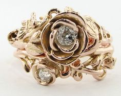This ring is actually 2 separate rings: the engagement ring (the big rose) and the wedding ring (the smaller rose).