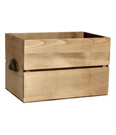 Wooden box with a stained finish. Metal handle on one short side. Size 7 1/2 x 7 1/2 x 11 1/2 in.