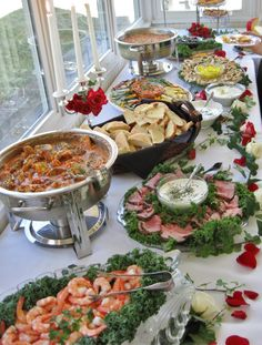 Another view of finger foods at a wedding recpetion we catered with beef tenderloin and horseradish sauce in the foreground, chicken tenderloin in herb sauce, breads, cheeses, roasted veggies, wraps, Hot crabdip, etc..