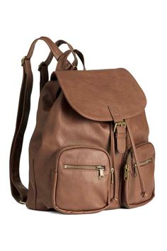 Backpack: Backpack in imitation leather with metal details, a flap with a press-stud and drawstring at the top, a handle, adjustable shoulder straps, and two outer pockets with double zips which means they can be opened at the top and at the front. Lined. Size 31.5x37 cm.