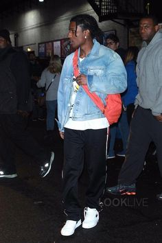ASAP Rocky wearing Gucci Denim jacket with embroideries, Nike Air Force 1 Low Sneakers, Gucci Graphic Tee