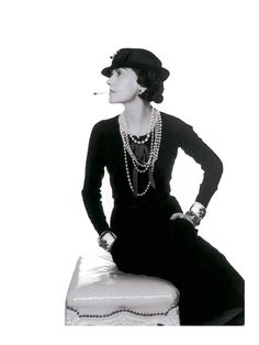 1937: Gabrielle Chanel photographed by Man Ray.  A little black dress, pearls and a hint of provocation. © Chanel