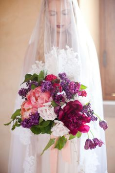 beautiful overblown peony and lilac bridal bouqet