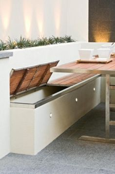 Outdoor storage bin/bench. Don't like style but Like the lid concept.... Should add cushion rails to sides and back.