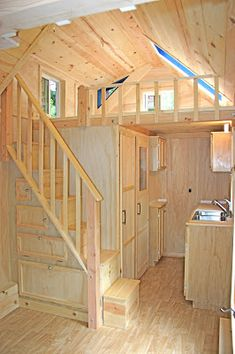 House #5. 136 sq ft. | Molecule Tiny Homes--I like the stair and kitchen layout