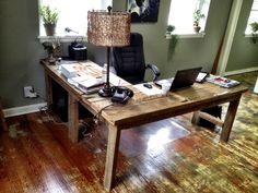 L-shaped desk that I build out of salvaged floor boards from an old shotgun house that once stood on my family's farm.