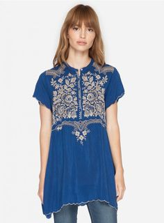 Britta Tunic The Johnny Was BRITTA TUNIC features a feminine Folk Art-inspired embroidery design in a subtle color palette on flowy rayon georgette. With a split trapeze hemline, cap sleeves, and henley button front, this boho embroidered blouse is as figure-flattering as it is chic! - Rayon Georgette - Mandarin Collar, Five Button Henley Front, Cap Sleeves, Split Trapeze Hem - Signature Embroidery - Care Instructions: Machine Wash Cold, Tumble Dry Low